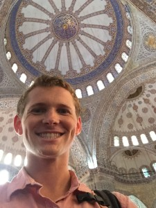 Inside the Sultan Ahmed Mosque (Blue Mosque).  The upper levels of the interior are dominated by blue paint. More than 200 stained glass windows with intricate designs admit natural light, today assisted by chandeliers.