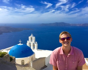 With the blue domes of Fira.  Without instructions it is very hard to find this view because the area is so dense.