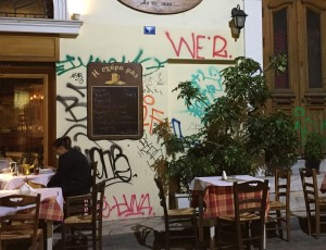 Here is the vandalized side of a restaurant that was featured in Athens Michelin guide just a few years ago.