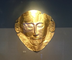 "The Mask of Agamemnon is an artifact discovered at Mycenae in 1876 by Heinrich Schliemann. The artifact is a funeral mask made in gold, and was found over the face of a body located in a burial shaft, designated Grave V, at the site ""Grave Circle A, Mycenae""."