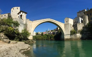Here is the Stari Most (Old Bridge).  The Old Bridge, built by the Ottomans in the 16th century, is one of Bosnia and Herzegovina's most recognizable landmarks, and is considered one of the most exemplary pieces of Islamic architecture in the Balkans.  In 1993 it was destroyed in a sort of Civil War within Bosnia.  this topic is still VERY sensitive, and it was rebuilt in 1995 using as much original stone as possible.