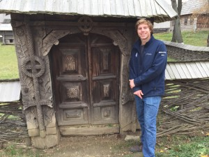 A picture of Anders in the village museum where you can explore traditional Romanian home.s