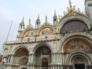 Outside of St. Marks Basilica.  Notice the different colors of marble that compose the outside columns.
