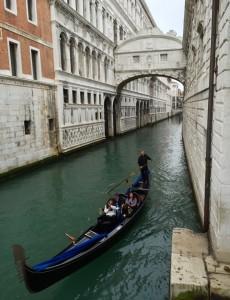 A gondola on the canal beneath the Bridge of Sighs.