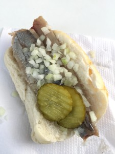 The infamous herring sandwich.  You eat it bones and all, and it tastes like herring with bread.