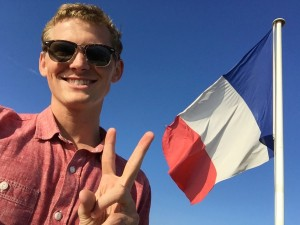 Me with a flag. Still throwing up the peace sign, even months after leaving Asia.